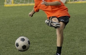 Girl kicks a soccer ball