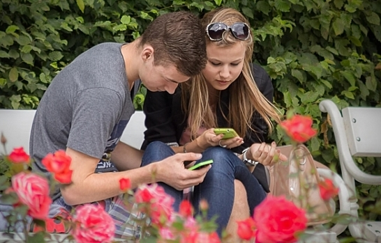 girl and boy phone users