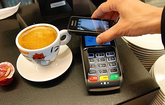 http://commons.wikimedia.org/wiki/File:Mobile_payment_03.JPG