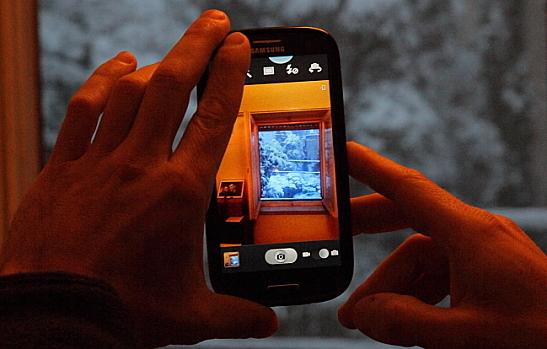 Man using camera phone