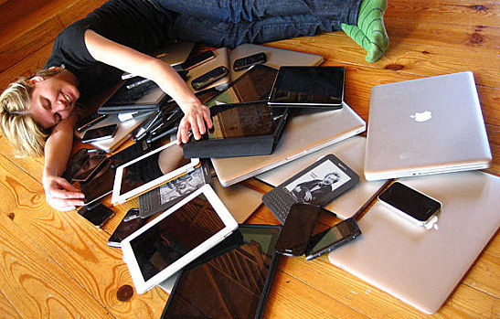 Woman with multiple mobile devices