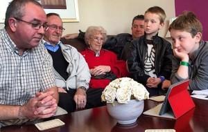 Family sitting around an ipad