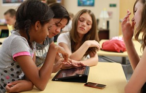 Girls using iPad to learn