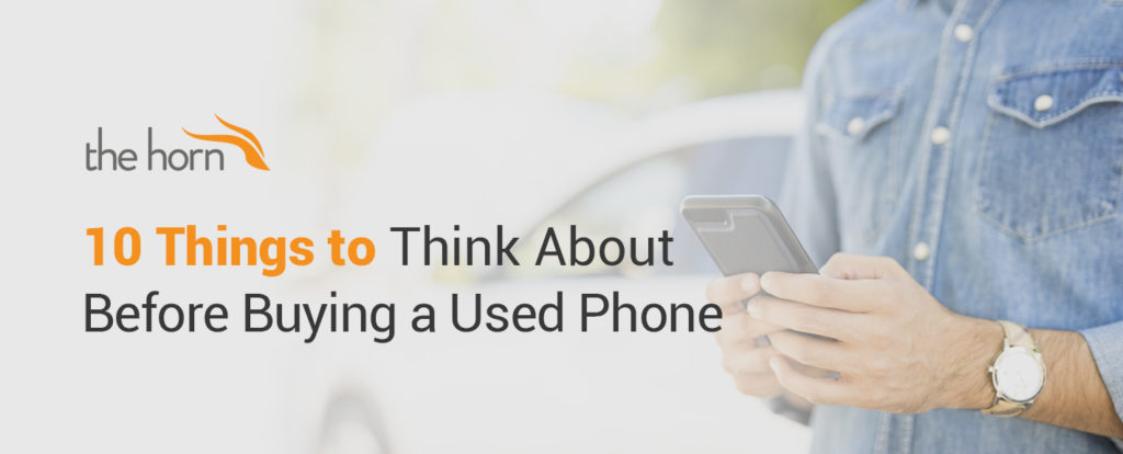 10 Things to Think About Before Buying a Used Phone - Man Holding Cellphone